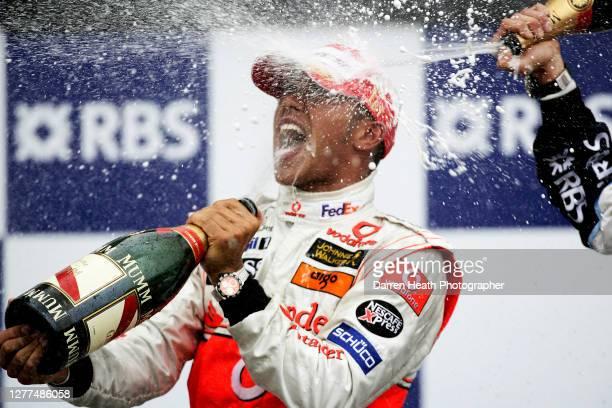British McLaren Formula One driver Lewis Hamilton celebrates winning his first Grand Prix on the winners podium of the 2007 Canadian Grand Prix held...