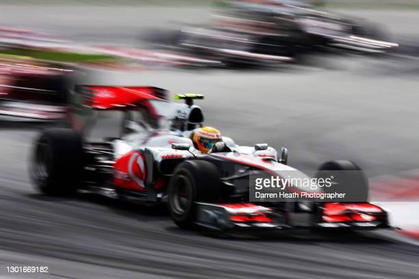 British McLaren Formula One driver Lewis Hamilton driving his McLaren MP4-25 racing car during the 2010 Malaysian Grand Prix, Sepang International...
