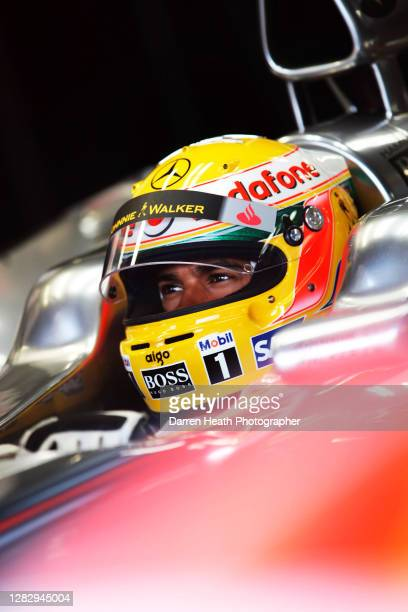 British McLaren Formula One driver Lewis Hamilton sits in his MP4-23 racing car during practice for the 2008 Monaco Grand Prix, Monte Carlo, on the...