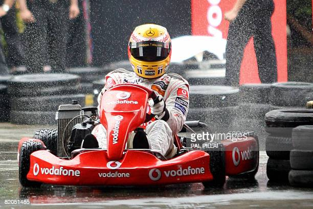 British McLaren Formula One motor racing driver Lewis Hamilton drives a gokart during a promotional event in Mumbai on July 24 2008 India became...