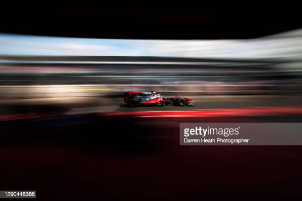British McLaren Formula One racing driver Jenson Button driving his McLaren MP4-25 racing car during practice for the 2010 British Grand Prix,...