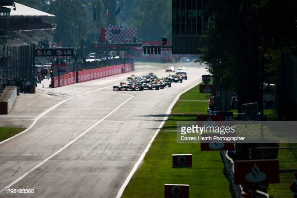 British McLaren Formula One racing driver Jenson Button leads the field ahead of pole position starting Ferrari driver Fernando Alonso and the entire...