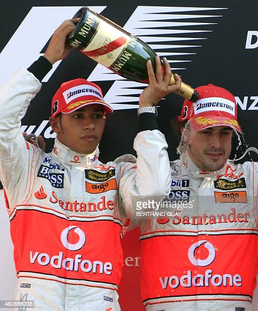 British McLarenMercedes driver Lewis Hamilton and Spanish McLarenMercedes driver Fernando Alonso celebrate at the Monza racetrack 09 September 2007...