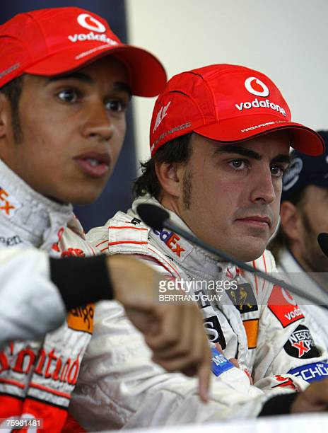 British McLaren-Mercedes driver Lewis Hamilton and team mate Spanish Fernando Alonso attend a press conference at the Hungaroring racetrack, 04...