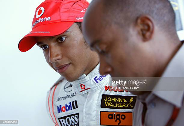 British McLarenMercedes driver Lewis Hamilton walks with his father Anthony at the Hungaroring racetrack 04 August 2007 in Budapest after the...