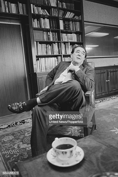 British media magnate and owner of The British Printing Corporation Robert Maxwell pictured sitting in a chair in his office in London on 11th August...