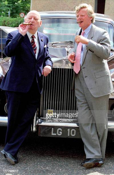British media mogul Lew Grade with his nephew Michael Grade smoking cigars by a Rolls Royce circa 1985 The car's numberplate reads 'LG10'