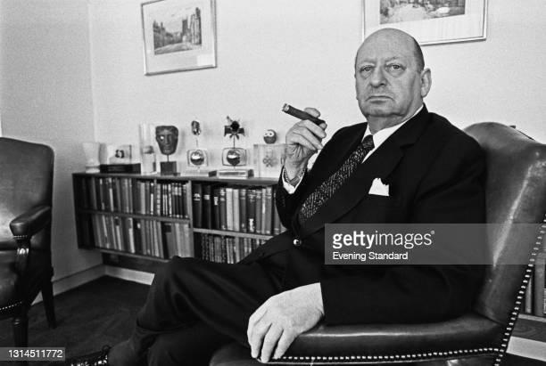 British media proprietor Sir Lew Grade of ATV , UK, 16th May 1974. On the shelf behind him is a BAFTA award.