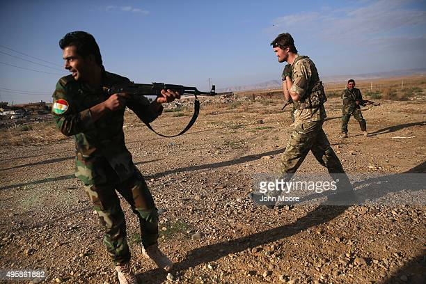British member of a group called the International Peshmerga Volunteers instructs Kurdish troops during a Combat Lifesaver Course on November 5 2015...