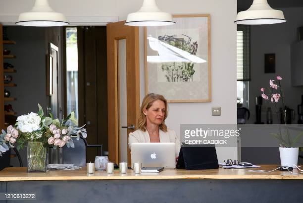 British Member of Parliament for Bath, Liberal Democrat Wera Hobhouse, works on a laptop during the novel coronavirus COVID-19 pandemic from her home...