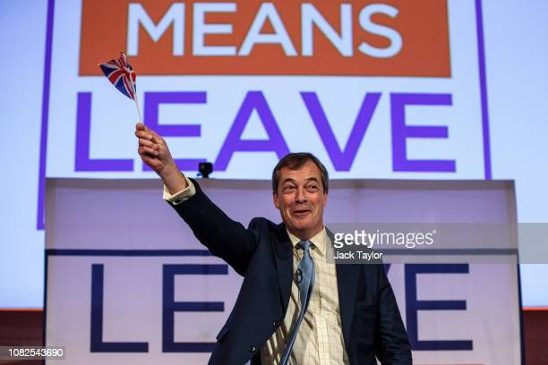 British MEP Nigel Farage waves a Union flag during a 'Leave Means Leave' Brexit rally at the Queen Elizabeth II Centre on December 14 2018 in London...
