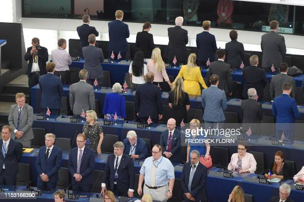 TOPSHOT British MEPs Brexit Party turn their backs during the European anthem ahead of the inaugural session at the European Parliament on July 2...