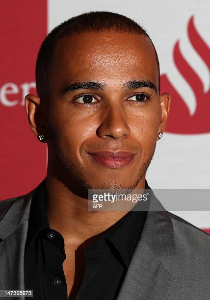 British Mercedes McLaren Formula 1 driver Lewis Hamilton poses during the launch of a proposed F1 race through London in Central London on July 28...