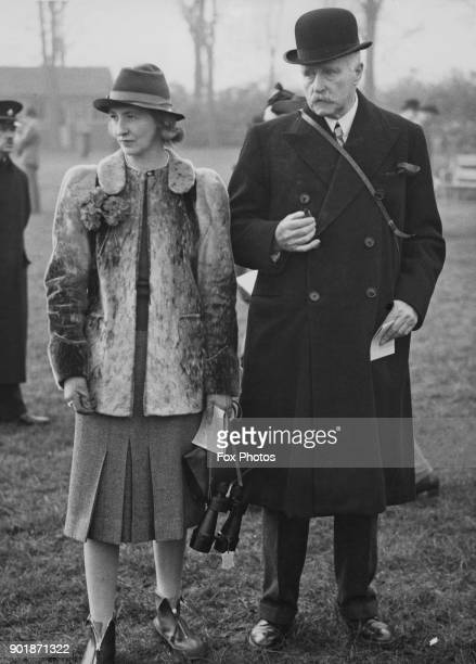 British merchant banker Vivian Smith 1st Baron Bicester and Mrs Mure at the first steeplechase meeting to be held during World War II in Leicester UK...
