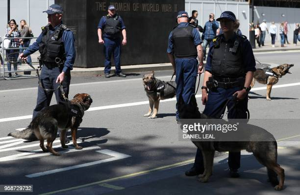 British Metropolitan Police officers stand on duty with their police dogs during a protest against Turkey's President Recep Tayyip Erdogan outside...