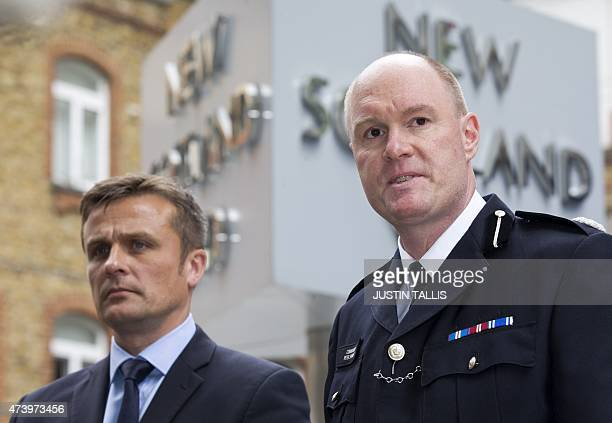 British Metropolitan Police's Detective Superintendent Craig Turner and Commander Peter Spindler speak to journalists outside New Scotland Yard in...