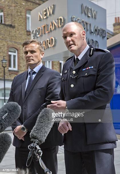 British Metropolitan Police's Detective Superintendent Craig Turner and Commander Peter Spindler speak to journalists during a news conference...