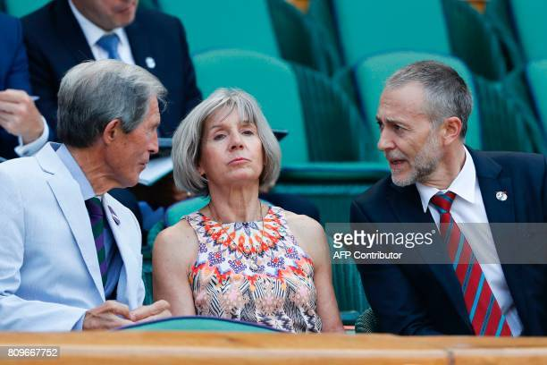 British Michelin starred chef Michel Roux and his wife Giselle sit in the royal box on Centre Court as France's Gael Monfils play against Britain's...