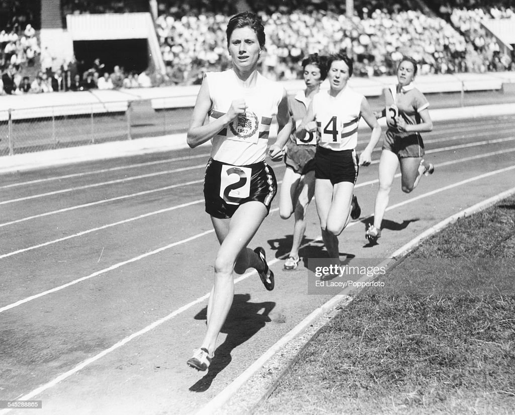 British middle distance runner Diane Leather leads the field during a race, at White City stadium, London, August 3rd 1957.