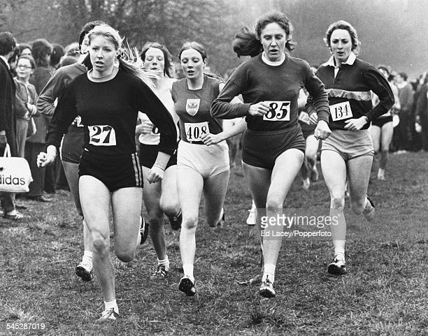 British middle distance runner Rita Ridley leads the field during the senior cross country race, ahead of Joyce Smith , Christine Haskett and...