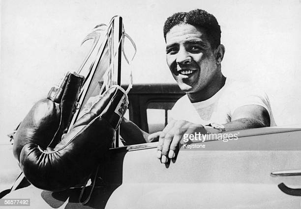 British middleweight boxing champion Randolph Turpin leaves his training quarters in Grossinger New York State for a quiet drive in his car shortly...