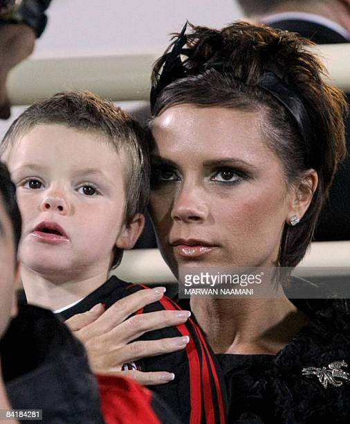 British midfielder David Beckham's wife Victoria and her son Cruz Beckham are seen in the stands before the start of the football match between AC...