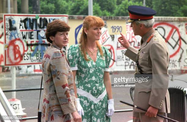British military governor of Berlin Robert Corbett and wife of the mayor Anne Momper show Berlin Wall to Sarah Duchess of York on the 24th of May in...
