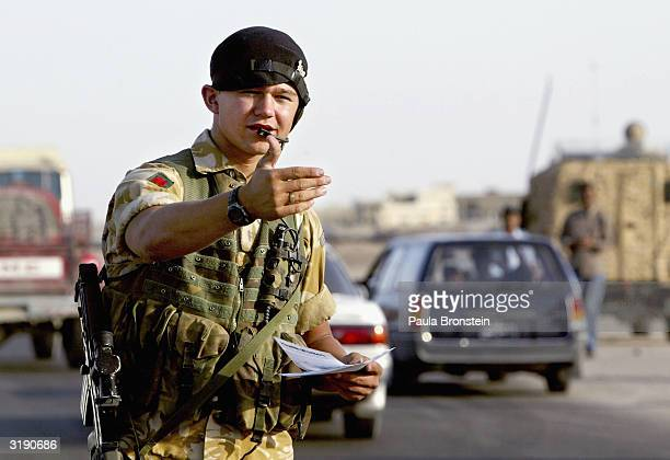 British military hand out anti-terrorists leaflets in Basra