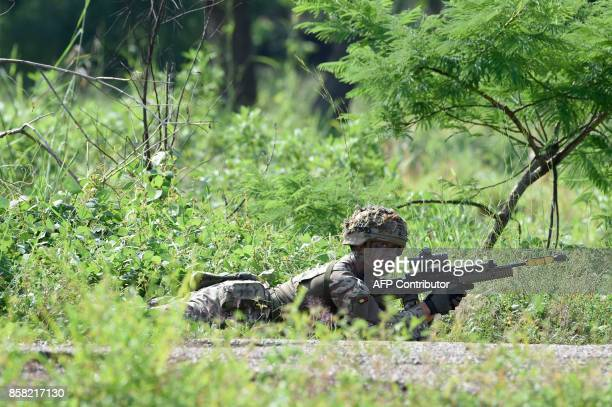 British military instructors take part in a demonstration for Nigerian soldiers during a training session at 707 Special Forces Brigade in Makurdi...