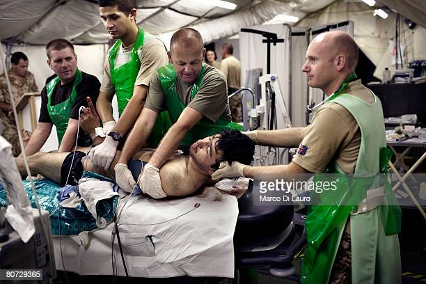 British military medical personnel from the UK Med Group load Afghan National Army soldier Bashir into a bed at the RESUS on June 8 2007 at the...