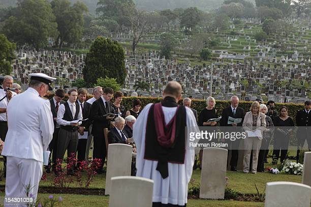 British military personnel British high commissioner and family members attend the burial of eight RAF crew members at the Commonwealth War Cemetery...