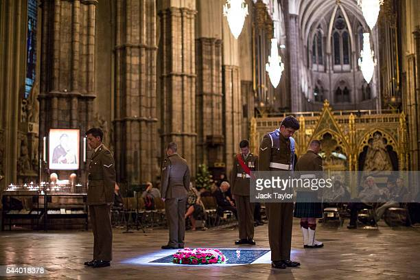 British Military personnel LBdr Walsh LCpl Drury LCpl Kinmond Cpl Wolfe and Sgt Cohoon stand at the Grave of the Unknown Warrior during a vigil to...