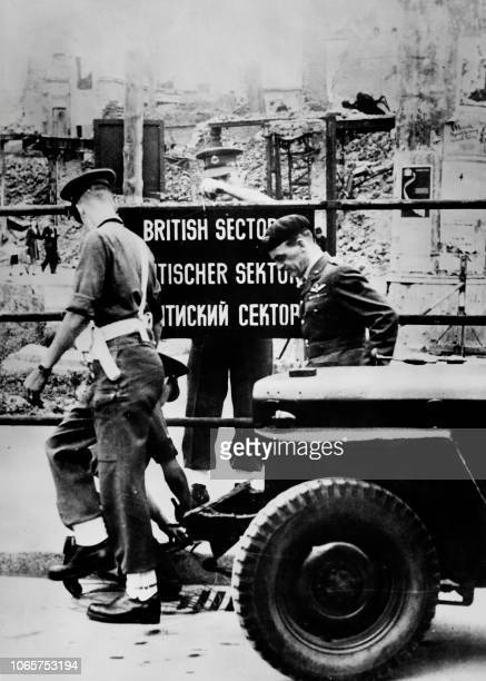 British military police set up signs in English German and Russian to mark the different areas of Berlin in August 1948 during the Berlin blockade