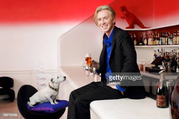 British milliner Philip Treacy with his Jack Russell terrier Mr Pig photographed at Sketch London on 3rd September 2003