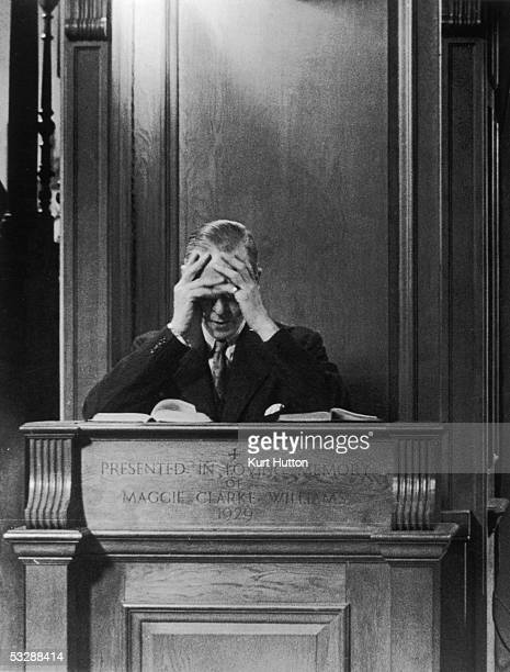 British Minister for Aircraft Production Sir Stafford Cripps bows his head in prayer after giving a sermon at St Jude's in Hampstead Garden City on...