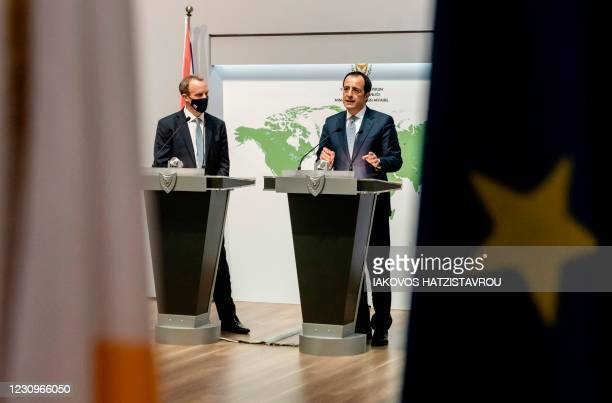 British Minister of Foreign Affairs, Dominic Raab , listens to his Cypriot counterpart Nikos Christodoulides during a joint press conference after...