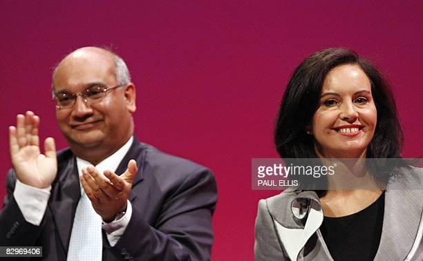 British Minister of State for Housing and Planning Caroline Flint is applauded by MP Keith Vaz after making her speech during the 2008 Labour Party...