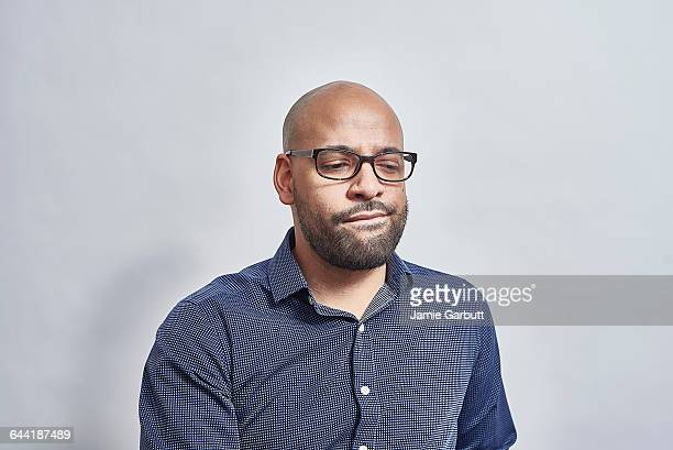 a british mixed race male looking concerned - miscigenado - fotografias e filmes do acervo