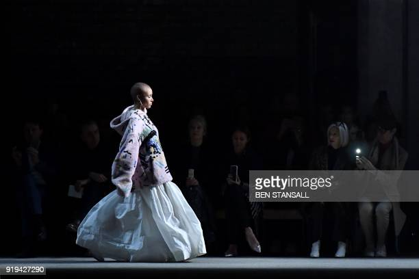 British model Adwoa Aboah presents a creation from the Burberry collection during their catwalk show on the second day of London Fashion Week...