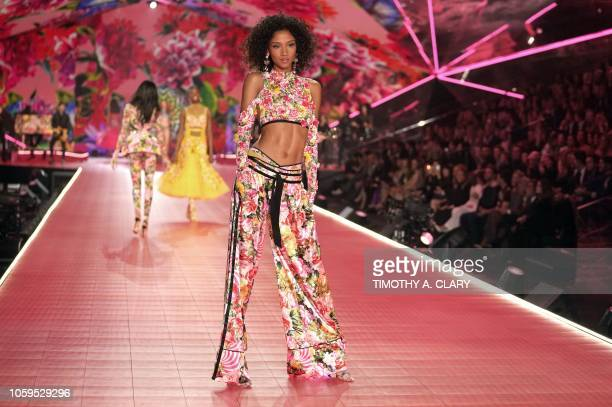 British model Aiden Curtiss walks the runway at the 2018 Victoria's Secret Fashion Show on November 8 2018 at Pier 94 in New York City Every year the...