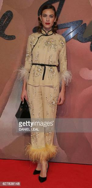 British model Alexa Chung poses for pictures on the red carpet upon arrival to attend the British Fashion Awards 2016 in London on December 5 2016 /...