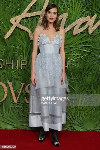 British model Alexa Chung poses on the red carpet upon arrival to attend the British Fashion Awards 2017 in London on December 4 2017 The prestigious...