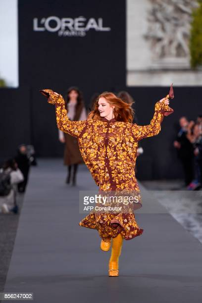 British model Alexina Graham takes part in the L'Oreal fashion on the sidelines of the Paris Fashion Week on October 1 on a catwalk set up on the...