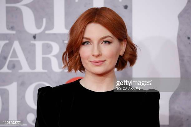 British model Alice Levine poses on the red carpet on arrival for the BRIT Awards 2019 in London on February 20 2019 / RESTRICTED TO EDITORIAL USE NO...