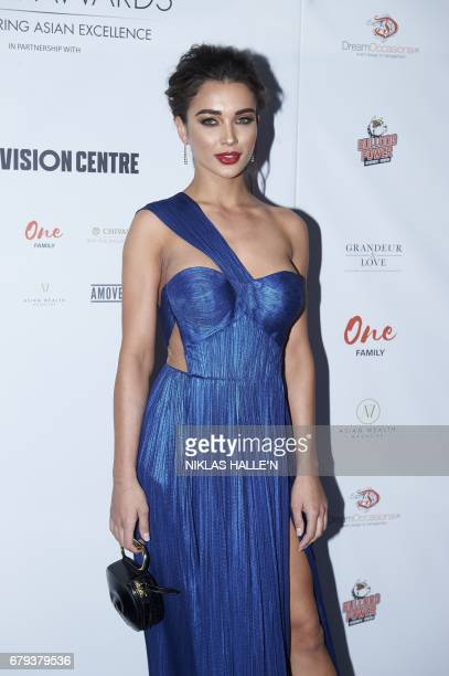 British model and actress Amy Jackson poses for a photograph on arrival for the Asian awards in central London on May 5 2017 / AFP PHOTO / Niklas...