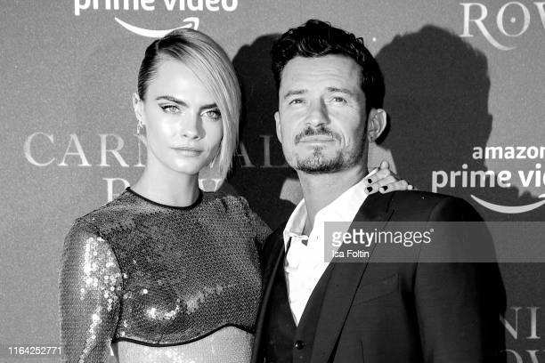 British model and actress Cara Delevingne and british actor Orlando Bloom attend the Carnival Row Special Screening at Astor Film Lounge on August 26...