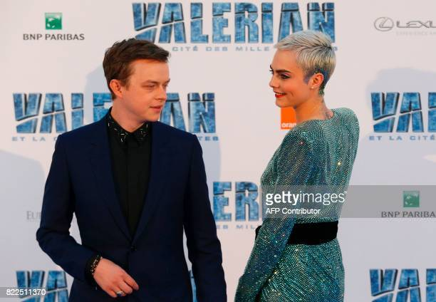 British model and actress Cara Delevingne and US actor Dane DeHaan pose for a photograph upon arrival for the prepremiere of the film 'Valerian and...