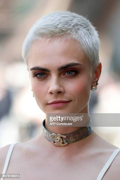 British model and actress Cara Delevingne poses during the photocall before Chanel 20172018 fall/winter Haute Couture collection show in Paris on...