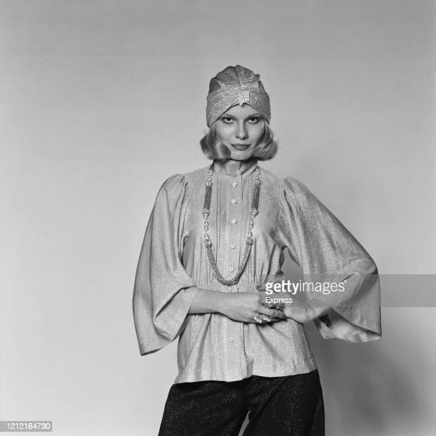 British model and actress Suzy Miller wearing a Lurex blouse with angel sleeves a turban and a long necklace for a studio fashion shoot 15th...