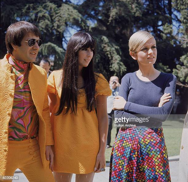 British model and actress Twiggy with American singing duo Sonny Bono and Cher at an outdoor party given to welcome Twiggy to Los Angeles Beverly...